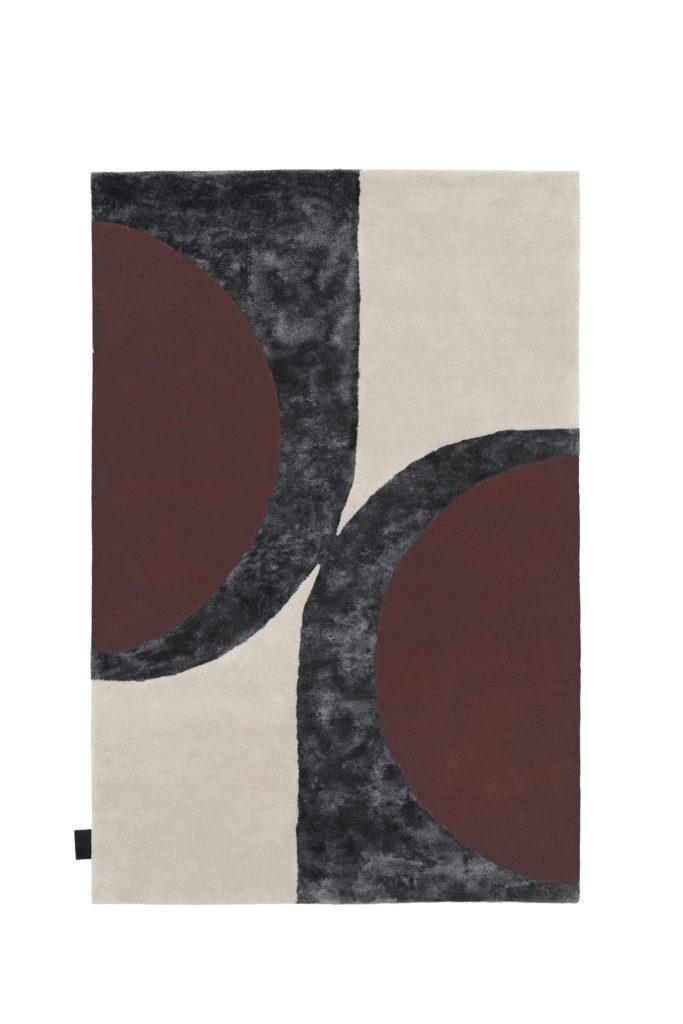 Matta i färgerna vitt, grått och rött